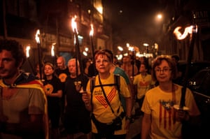 Demonstrators hold torches during a pro-independence demonstration in Barcelona.