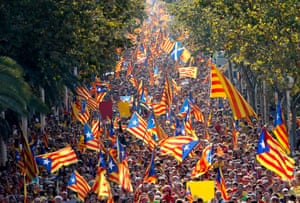 Hundreds of thousands of Catalans throng the streets of Barcelona to demand the right to vote on a split from Spain