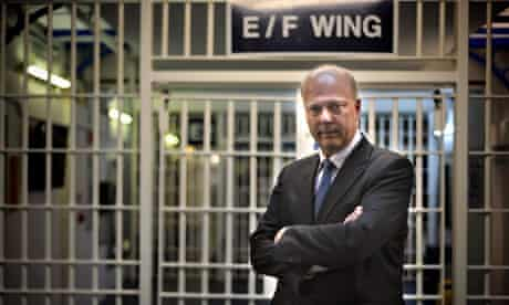 Chris Grayling visiting a prison. Questions have been raised about contracts drawn up by his departm