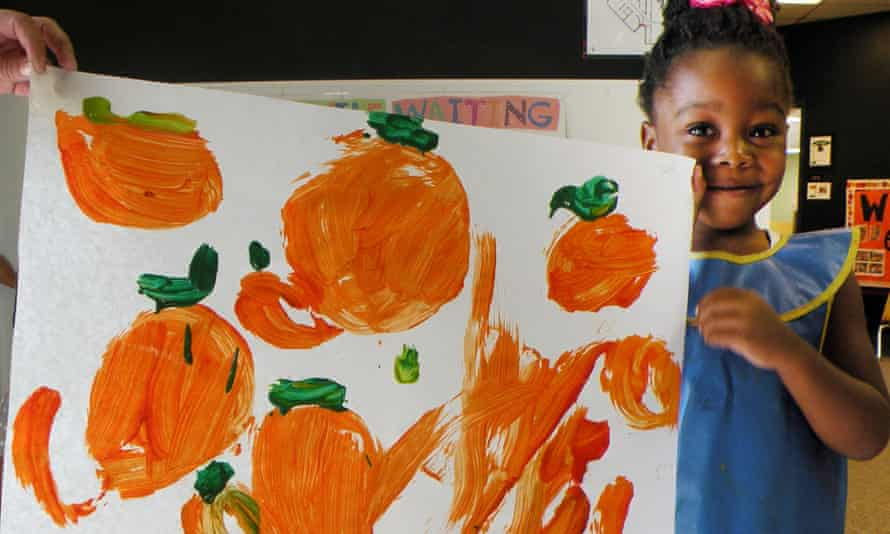In this photo taken on Sept 9, 2014, and provided by the Child Development Center, student Oluwafunto Akinnurele holds a picture of pumpkins stolen from the Child Development Center at Eastern New Mexico University.