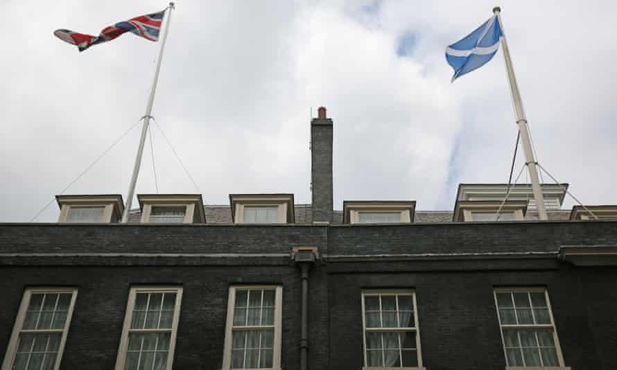 A Union flag and a Scottish Saltire flag fly over Downing Street on September 10, 2014 in London