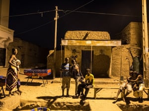 Locals socialise in the cool night air in Timbuktu.