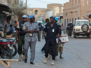 United Nations police on a foot patrol through the centre of Timbuktu.