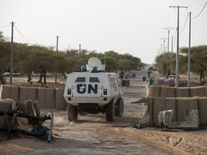 A UN armoured vehicle returns to Timbuktu's city limits after a patrol to the Niger river at Korioumé.