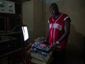 A DJ performs a sound check in the only nightclub in Timbuktu.