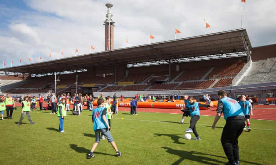 Children show off their skills at the annual Open Day of the Johan Cruyff Foundation at the Olympic Stadium in Amsterdam.