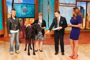 Guinness world record holders Kazuhiro Watanabe, the man with the tallest hair (3ft 8.6in) and Zeus, the tallest dog, appear on the Wendy Williams Show in New York City in 2012