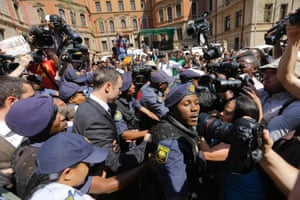 Oscar Pistorius is escorted by police officers as he leaves the court after his conviction for the culpable homicide of Reeva Steenkamp.