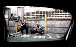 Iranians vendors drinking tea on a sidewalk in Azadi (Freedom) Square in western Tehran on June 4, 2013.