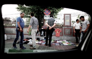 Iranians shop for shirts from a street vendor at Azadi Square in western Tehran on June 4, 2013.