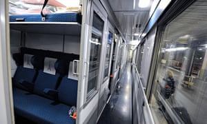A picture shows a cabin and a corridor of a Thello train, of French Veolia Transdev and Italian Thre