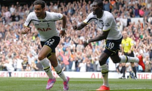 Tottenham Hotspur's Nacer Chadli, left, celebrates his second goal against Queens Park Rangers with teammate Emmanuel Adebayor during a match at White Hart Lane