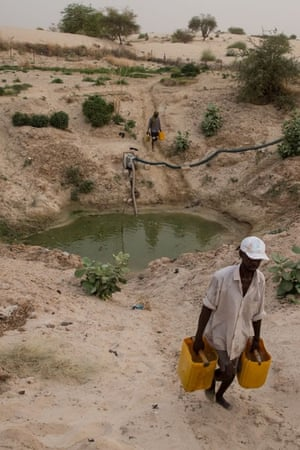 Men collect water from one of Timbuktu's few remaining waterholes.