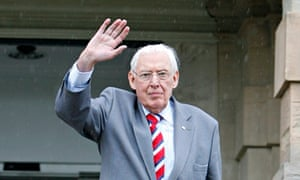 Ian Paisley waves goodbye on the steps of Stormont Castle in Belfast