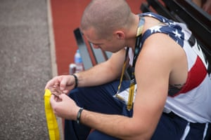 An American competitor looks fondly at his bronze medal.
