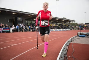 Marianne Huche of Denmark running with her walking stick in the womens 1500m IT1 final.
