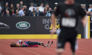 Derek Derenalagi of Great Britain lies on the track after falling in the mens 200m ambulant IF2 final.