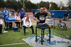 Shah Jahan of Afghanistan competing in the men's seated shot put IF4 final.
