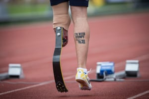 Redmond Ramos of USA with an amusing tattoo as he prepares to start in the final of the men's 100m ambulant IT1.