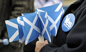 A pro-independence supporter holds campa
