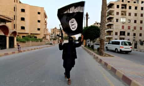 A member loyal to the ISIL waves an ISIL flag in Raqqa