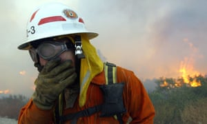 firefighter covers mouth smoke california