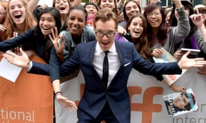 Benedict Cumberbatch poses with fans at The Imitation Game premiere.