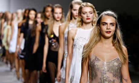Cara Delevingne leads models at Topshop Uniqe show