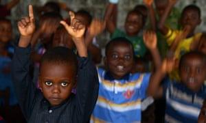 Children play at the Restoration Baptist church in Monrovia.