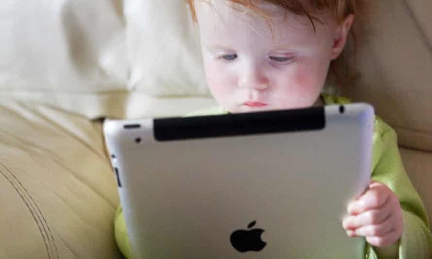 really cute kid with ipad