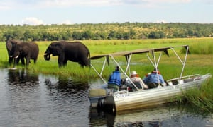 Foreign tourists in safari riverboats.