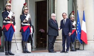 Iraqi President Fouad Massoum and French President Francois Hollande shake hands ahead of Paris conference.