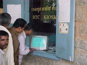 Farmers receiving services from bhoomi kiosk