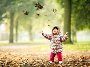 Child enjoying autumn in Buille Hill Park, Salford, Greater Manchester