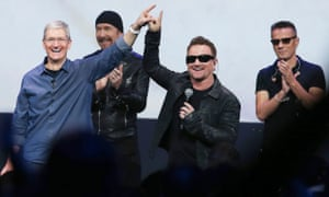 U2 and Apple CEO Tim Cook accidentally point in the same direction at the exact same time.