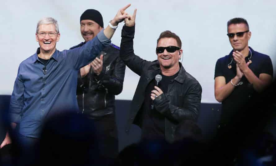 U2 and Apple CEO Tim Cook celebrated the band's album giveaway, but some iTunes users weren't so happy.