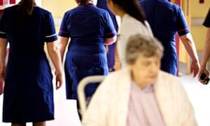 Woman and nurses in hospital, Birmingham Heartlands