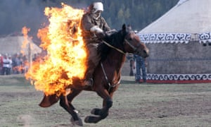 An athlete takes part in the World Nomad Games in Cholpon-Ata, around 170 miles from Bishkek, Kyrgyzstan, on 10 September 2014.