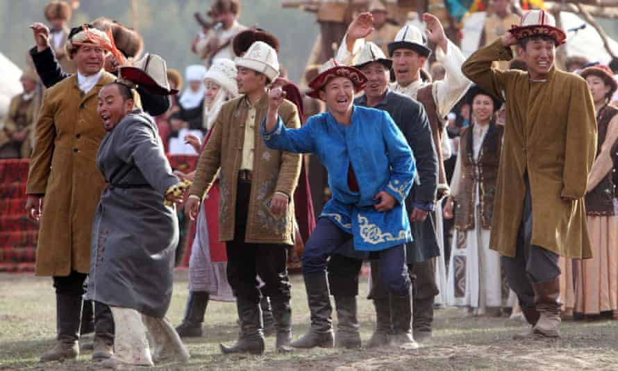 Bystanders cheers during the World Nomad Games in Cholpon-Ata.
