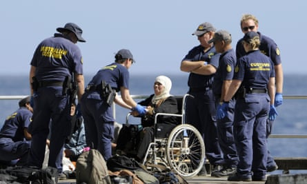 A woman is transferred to Christmas Island after being rescued from a boat in distress off Indonesia.