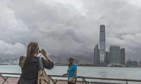 Chinese tourists take pictures in front