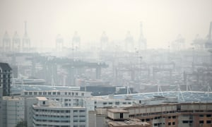 A general view over looking the Tanjong Pagar container port covered with smog in Singapore on September 15, 2014. Air pollution hit unhealthy levels due to smog from fires in Indonesia