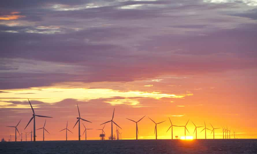 The Walney offshore windfarm project, off Barrow in Furness, Cumbria, UK, at sunset.