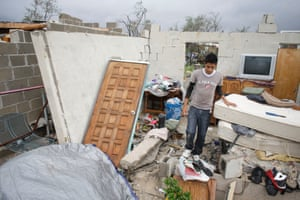 Raimundo Diaz, 17, walks inside what used to be a bedroom after his family's house was destroyed in Los Cabos