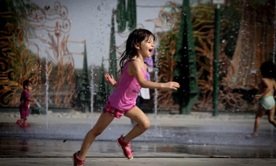 An Iranian girl runs at a park in Tehran, Iran, during a heatwave. August 2014 was the hottest on record, globally