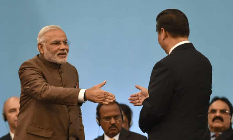 Indian Prime Minister Narendra Modi shakes hands with Chinese President Xi Jinping during the 6th BRICS Summit in the Brazilian city of Fortaleza.