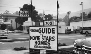A sign advertising tours round the homes of Hollywood movie stars.