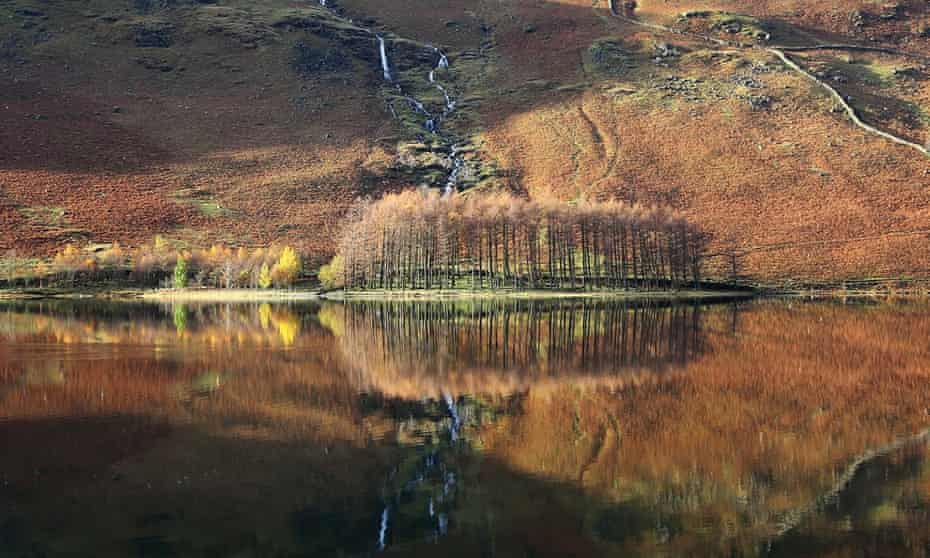 Autumn reflections on Buttermere in the Lake District.