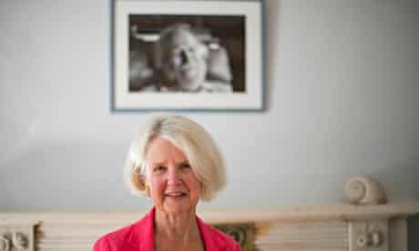 William Golding's daughter Judy Carver in front of a photograph of the author in his Cornwall home