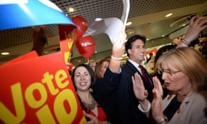 Ed Miliband makes his way through St James Shopping Centre in Edinburgh as shadow Scottish secretary Margaret Curran pushes demonstrators and supporters back
